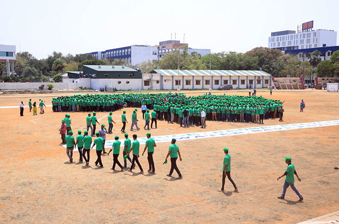 Forming the largest human recycling logo