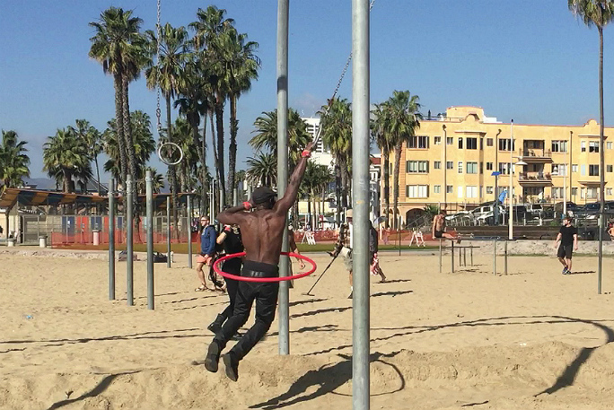 Longest distance swinging on rings while hula hooping 2