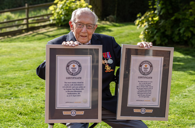 Captain Tom Moore with both of his Guinness World Records certificates / Credit: Emma Sohl - Capture The Light Photography