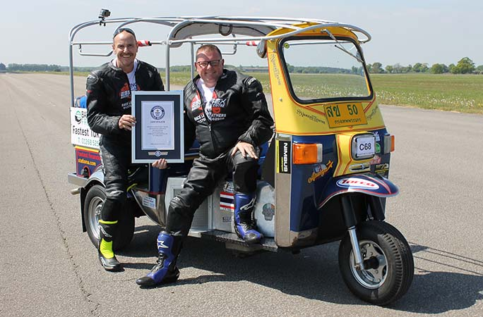 Russell-and-Matt-in-tuk-tuk-with-certificate.jpg